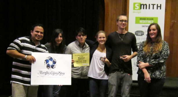"L to R: Holding the winning logo/sign design is Carlos Norat, joined by fellow team members Lusine Katrjyan, Juan Villanueva, Meghan Dougherty, Charles Leenstra, and client Jenna Wetmore from ""Morning Glory""."