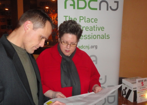 ADCNJ VP Andrew George goes over the member's list with President Sherry Fitzgerald.