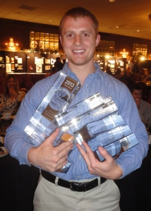 Here's Craig holding his 7 awards.