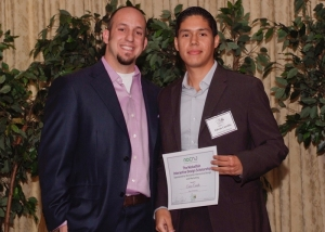 Nicklefish scholarship winner Eduarto Carrillo poses with Justin Martucci, Principal of Nicklefish.